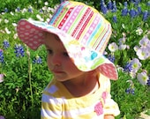 Infant's cute packable sun hat with wide brim, kitty cats and flowers, great sun protection