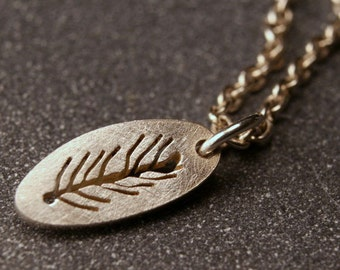 Tiny sterling silver charm hand pierced feather