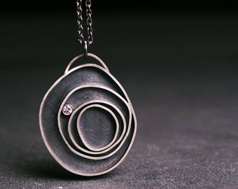Diamond and sterling silver concentric circle pendant   Orbit