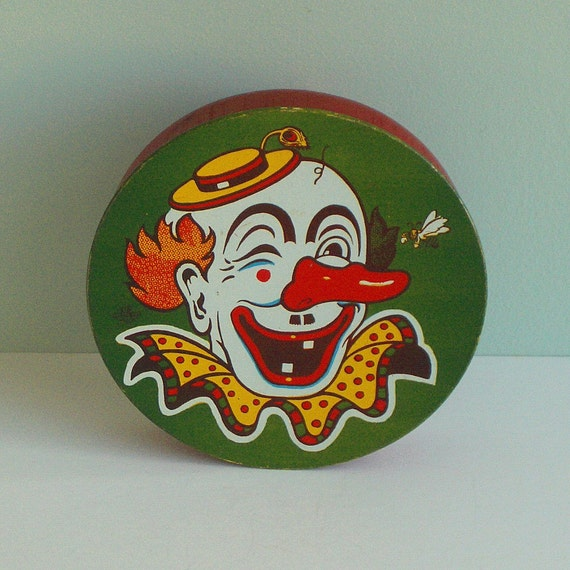 US Metal Toy Company's Winking Clown Noise Maker Toy