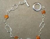 Silver Wire with Orange Beads Bracelets