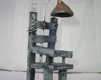 electric chair the HAUNTED CONSTRUCTION COMPANY.  miniature haunted antiques