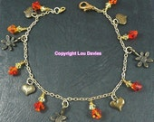 Bronze Summer Charm Bracelet. Gold with orange and yellow swarovski beads