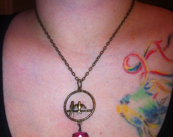 Love Birds Necklace in antique brass with Antique style glass jewel