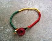 Wrapped Friendship Bracelet: Multi-Color Floss in Rasta, Size Medium