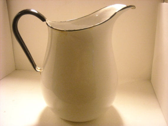 reserved....duck billed graniteware milk pitcher