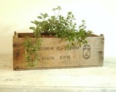 Vintage rustic wooden advertising case for storage and organization