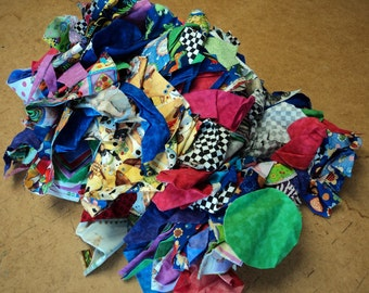 Ten pounds of quilting cottons assorted colors and sizes