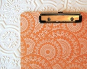 Tangerine spirograph covered clipboard, double sided