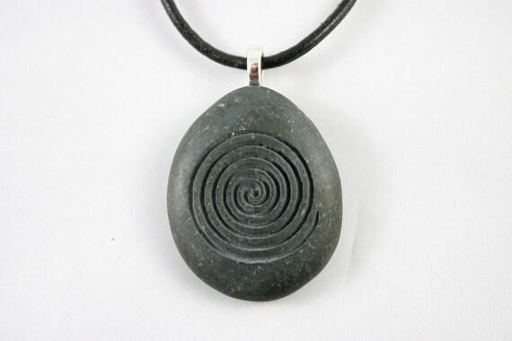 Spiral Engraved Gray Stone Symbolizes Growth Birth