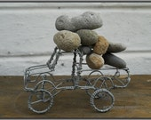 OVERLOAD - A LANDROVER CAN NEVER BE BROUGHT TO HIS KNEES - THE LANDROVER SERIES recycled wire art sculpture of a landrover