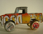 Metal truck toy made of scrap metal, tins, wire and bottle caps