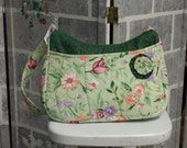 A New Shoulder Bag in Lovely Green Fabrics with Gold Leaves and Floral Designs.