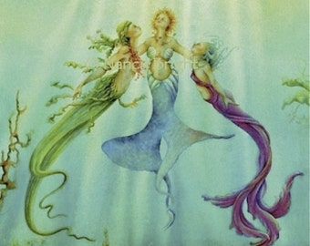Sisters Of The Sea - Three mermaids bask underwater in the rays of the sun