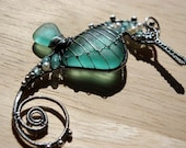 RESERVED for Paula. TEAL seahorse wire wrapped seaglass pendant.