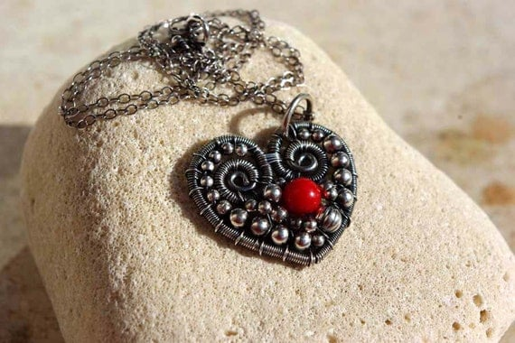 SACRE COEUR wiire wrapped sterling silver pendant with coral.