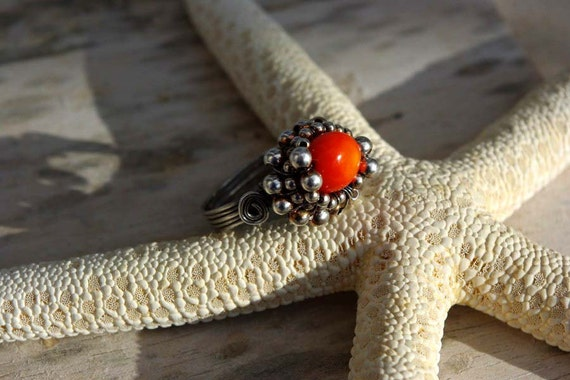 MASALA wire wrapped sterling silver ring with coral.