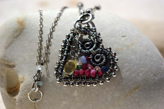FRIDAY I'M IN LOVE wire wrapped sterling silver heart necklace with precious gemstones.