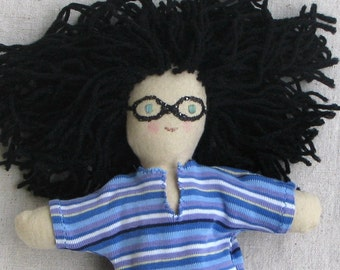 Cloth doll, one of a kind, 10 inch, brunette black hair, funky glasses, blue striped tee shirt and jeans
