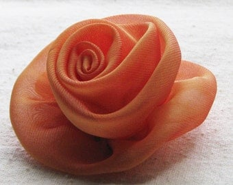 Rose hair clip, in tangerine orange chiffon fabric, medium