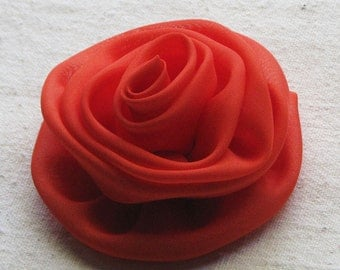 Rose hair clip, in bright persimmon orange fabric, 3 inch