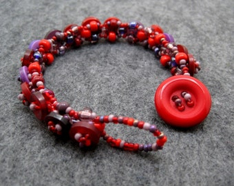 Beaded Bracelet - Button Embellished - Purple and Red by randomcreative on Etsy