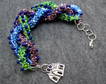 Beaded Bracelet - Building Together Green Blue Purple Braided Rope by randomcreative on Etsy