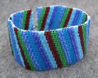 Beaded Cuff Bracelet - Multicolored Colorful Blue Green Purple Dark Red Diagonal Stripe by randomcreative on Etsy