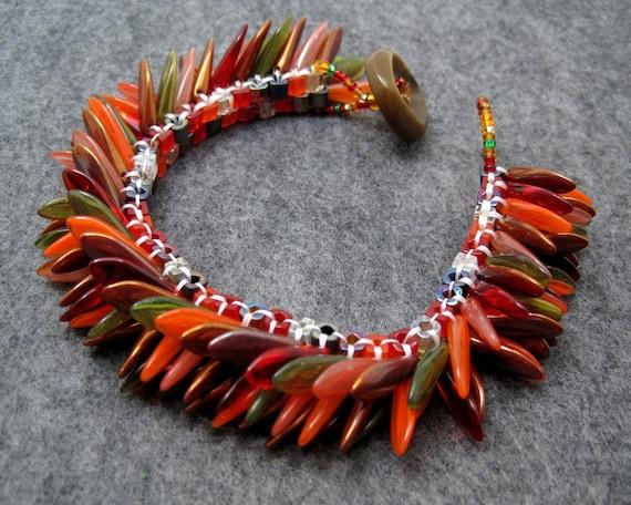 Beaded Cuff Bracelet - Dagger Fringed - Fall Autumn Red Orange Brown by randomcreative on Etsy