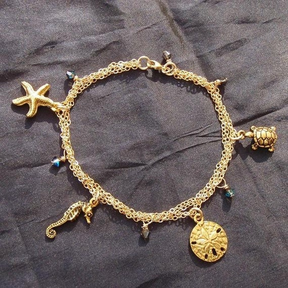 gold beachy charm bracelet sea turtle by treasuresoftheocean