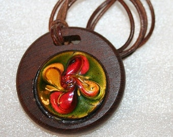 Vintage Artisan Made Glass Enamel on Wood Pendant Mid Century Red Yellow Green Walnut