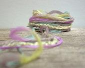 winter crocus fiber effects . 15yds of specialty yarns . lavender, cornsilk yellow, sky blue
