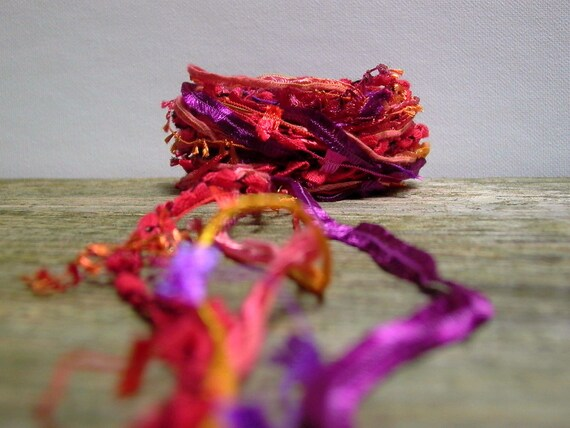 bird of paradise fiber effects . ribbon yarn bundle 12yds . red orange purple
