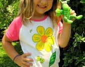 GIRL'S MAGNET T-SHIRT with funny magnetic grasshopper toy.