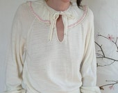 Cream colored sweater with ruffled collar