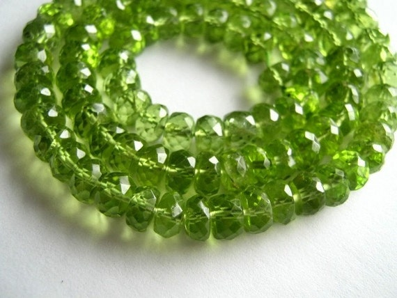 Large Peridot Faceted Rondelles, 6x4mm. Packet of 6 .. (11PER)