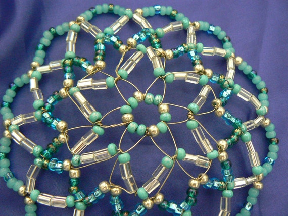 Clearance Kippah Sale!!!Handmade kippah in shades of teal, silver and clear glass czech beads.  Comes with a decorated gift box