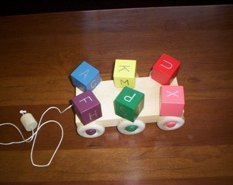 SPINNING BLOCKS Pull Toy with optional music button handcrafted & handpainted