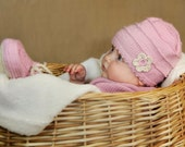 Pink baby hat with crochet flower from organic cotton yarn