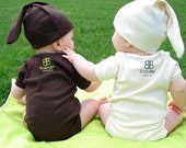 organic babybe hat in brown, green, natural, and pink