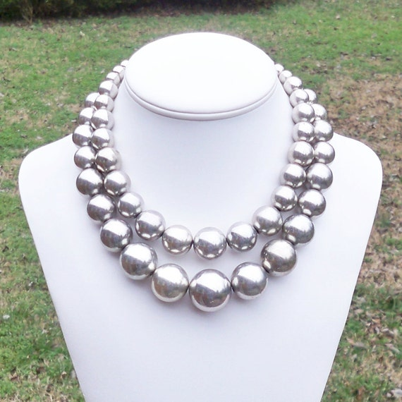 Neulla - Chunky, Graduated Double Strand Metallic Burnished Silver Beaded Necklace