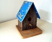 Cute vintage birdhouse made of barnwood and a 1967 Kansas license plate