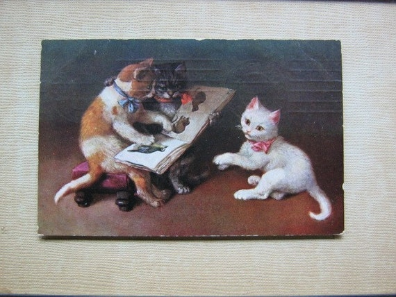 Antique German tinted postcard. Three litlle kitty's and the Animal book. 1908