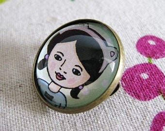 Kitty Mo Glass Brooch - Round bronze brooch with girl in cat headband