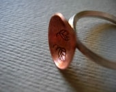 Copper disc cup with stamped leaves sterling silver ring