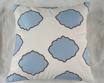 Off white 18 inch throw pillow with blue diamond applique