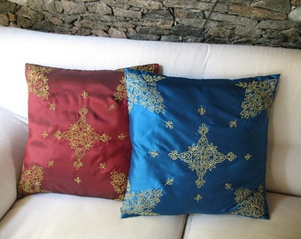 Red taffeta cushion cover with embroidery