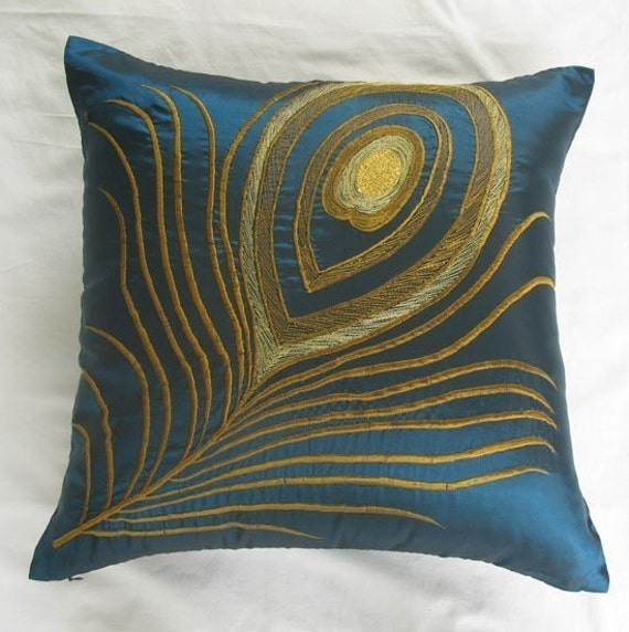 teal blue decorative throw pillow with peacock feather