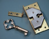 Small vintage unused 1960s 2-part brass/metal lock with kee for wooden boxes