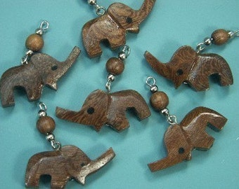 Lot of 10 today-hard-to-find vintage 1970s unused handworked dark brown teak wood elephant charms/pendants for your jewelry prodjects
